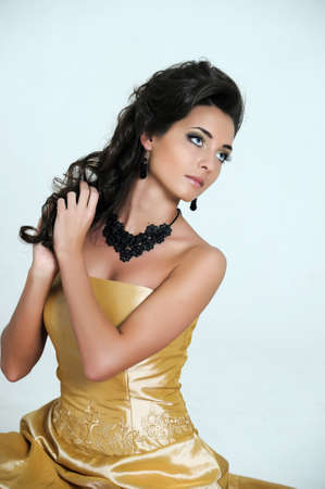 view of a beautiful woman in golden dress Stock Photo - 14999814