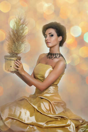 Beautiful girl in golden dress Stock Photo - 14999812