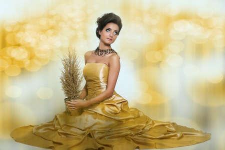 Beautiful girl in golden dress Stock Photo - 14999726
