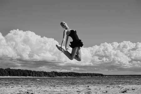 Happy healthy woman leaping on seashore on summer vacation Stock Photo - 15000128