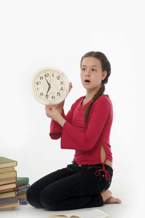 girl with clock and books Stock Photo - 14999946
