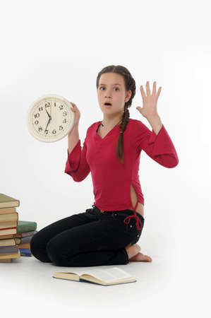 girl with clock and books Stock Photo - 14999945