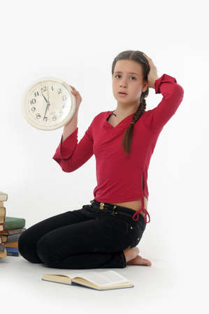 girl with clock and books Stock Photo - 14999947