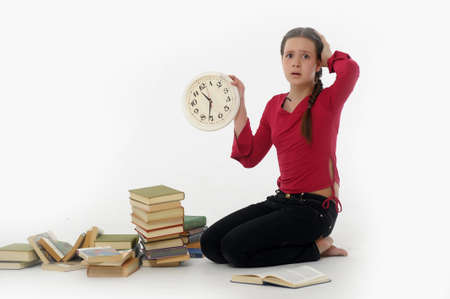 girl with clock and books photo