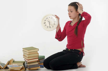 girl with clock and books Stock Photo - 14999923