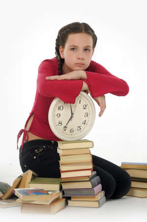 girl with clock and books Stock Photo - 15014595