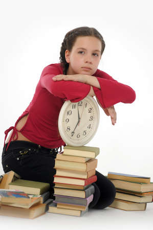 test deadline: girl with clock and books
