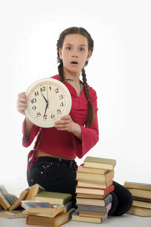 girl with clock and books Stock Photo - 15026624