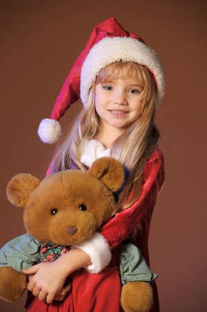 preteens girl: Christmas child with Teddy Bear