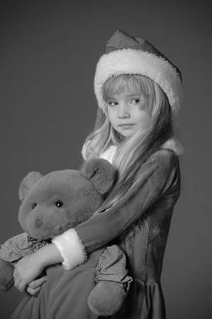 Christmas child with Teddy Bear  photo