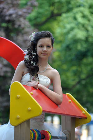 young bride on the playground photo
