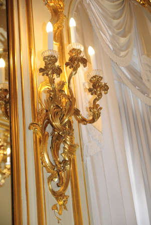 gold chandeliers in the interior photo