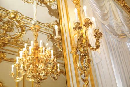 vintage chandelier: gold chandeliers in the interior Editorial