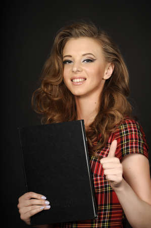 Beautiful smiley woman holding folder with papers Stock Photo - 15177299