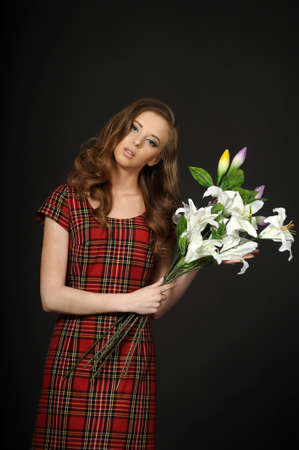 girl in a plaid dress with a bouquet of lilies Stock Photo - 15501978
