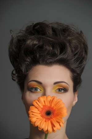 Young lady with  gerbera