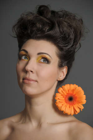 Young lady with  gerbera photo