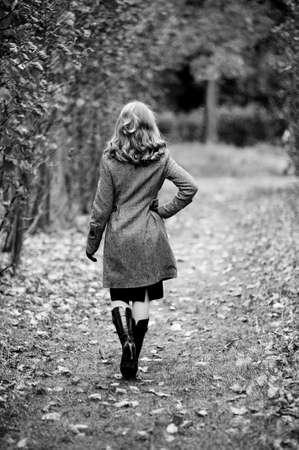 wide wet: girl in autumn park