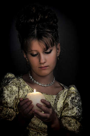 Young beautiful, girl portrait by glow of candlelight Stock Photo - 15145655