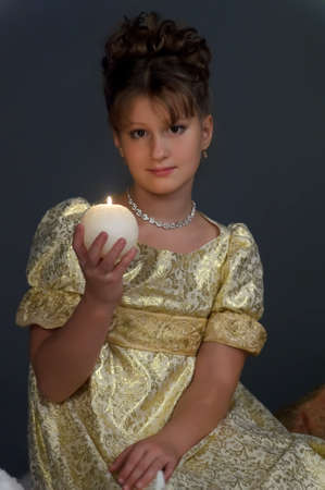 Young beautiful, girl portrait by glow of candlelight Stock Photo - 15126966