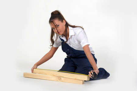 Young woman with tool belt is holding a metering rule  photo