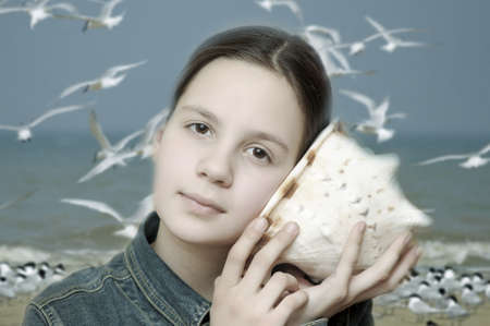 Girl with seashell photo