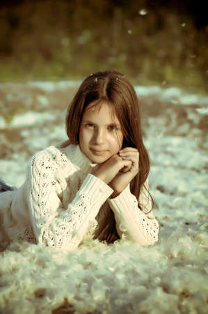 Young beautiful girl filled up by small feathers  Stock Photo - 15145027
