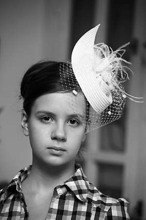 Face of young beautiful girl in a vintage hat  Stock Photo - 15147235