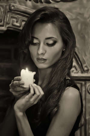 The brunette from candles in hands Stock Photo - 15145861