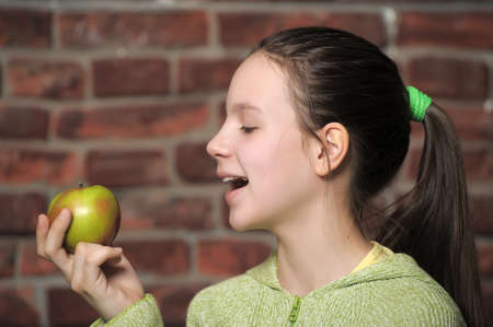 Teen eating green apple  Stock Photo - 15145104