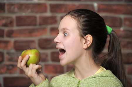 Teen eating green apple  Stock Photo - 15145096