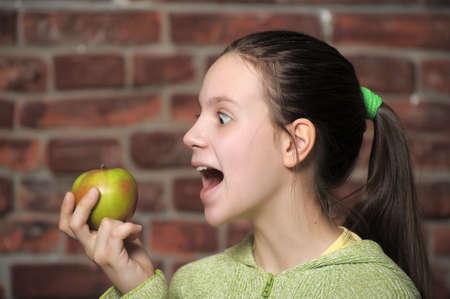 Teen eating green apple Stock Photo - 15145096