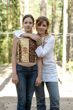 portrait of a woman with a daughter teenager photo