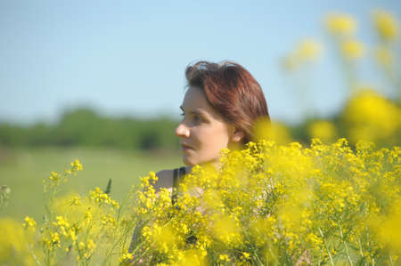 woman in a field of yellow flowers photo