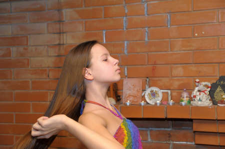 Pretty Girl Combing Her Hair photo
