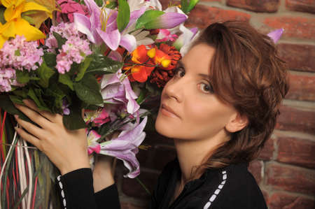 young woman with a big bouquet photo