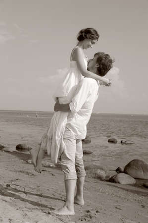 Beautiful couple at the beach , sepia photo