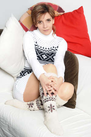 girl in a sweater and socks photo