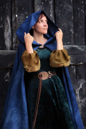 lass: girl in medieval dress and cloak