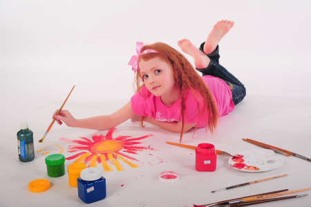 colored play: Girl painting on the floor Stock Photo