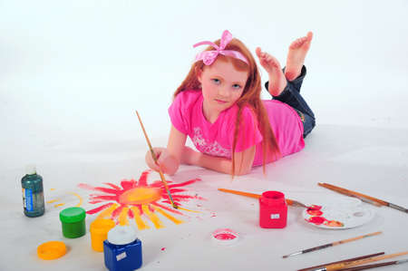 Girl painting on the floor photo