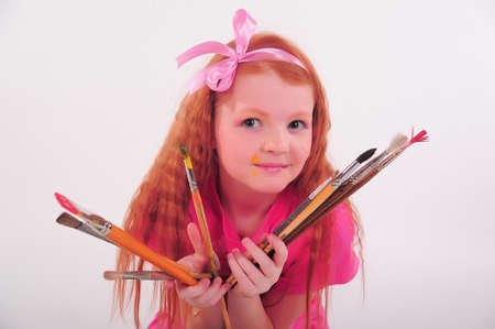 girl with brushes in hand photo