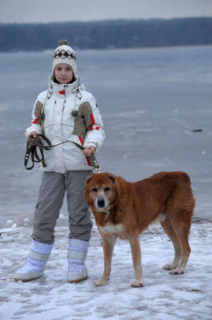 The girl the teenager with the Central Asian sheep-dog photo