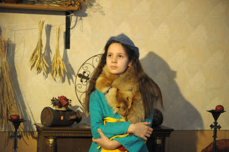 karoling: The girl in a medieval suit of the townswoman Stock Photo