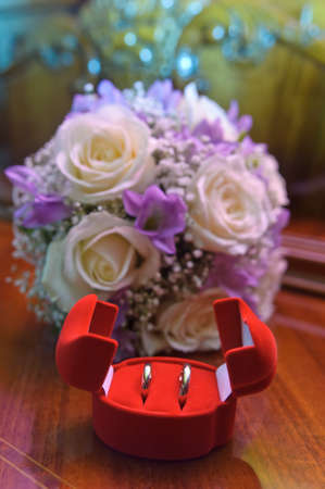 bridal bouquet and wedding rings in a box Stock Photo - 15151333