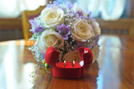 bridal bouquet and wedding rings in a box Stock Photo - 15151316