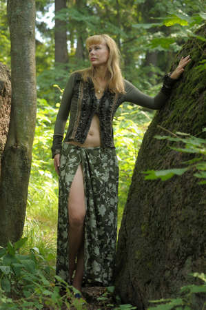 ancient sexy: woman in a green dress in the woods