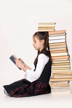girl with a big stack of books Stock Photo - 15151390