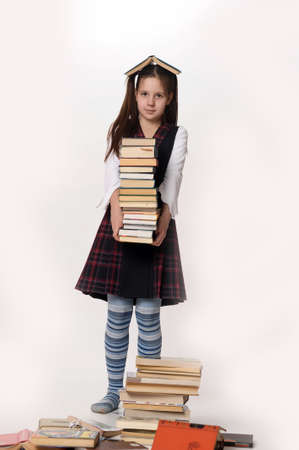 school girl sexy: girl with a big stack of books