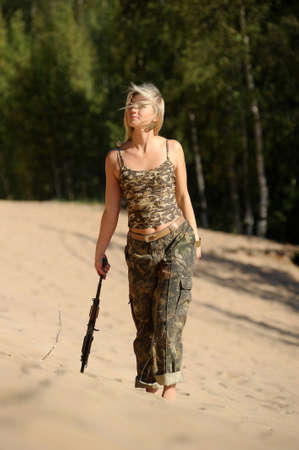 Woman with rifle photo